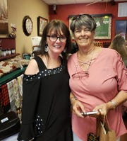 Owner Pam Shaia poses with Wanda Schultz during a recent tasting at From Olives and Grapes in Cocoa Village.