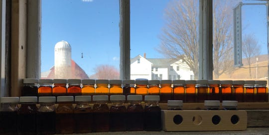 Sample bottles of maple syrup sit by a window in the Baird Farm's sugarhouse. March 20, 2019.