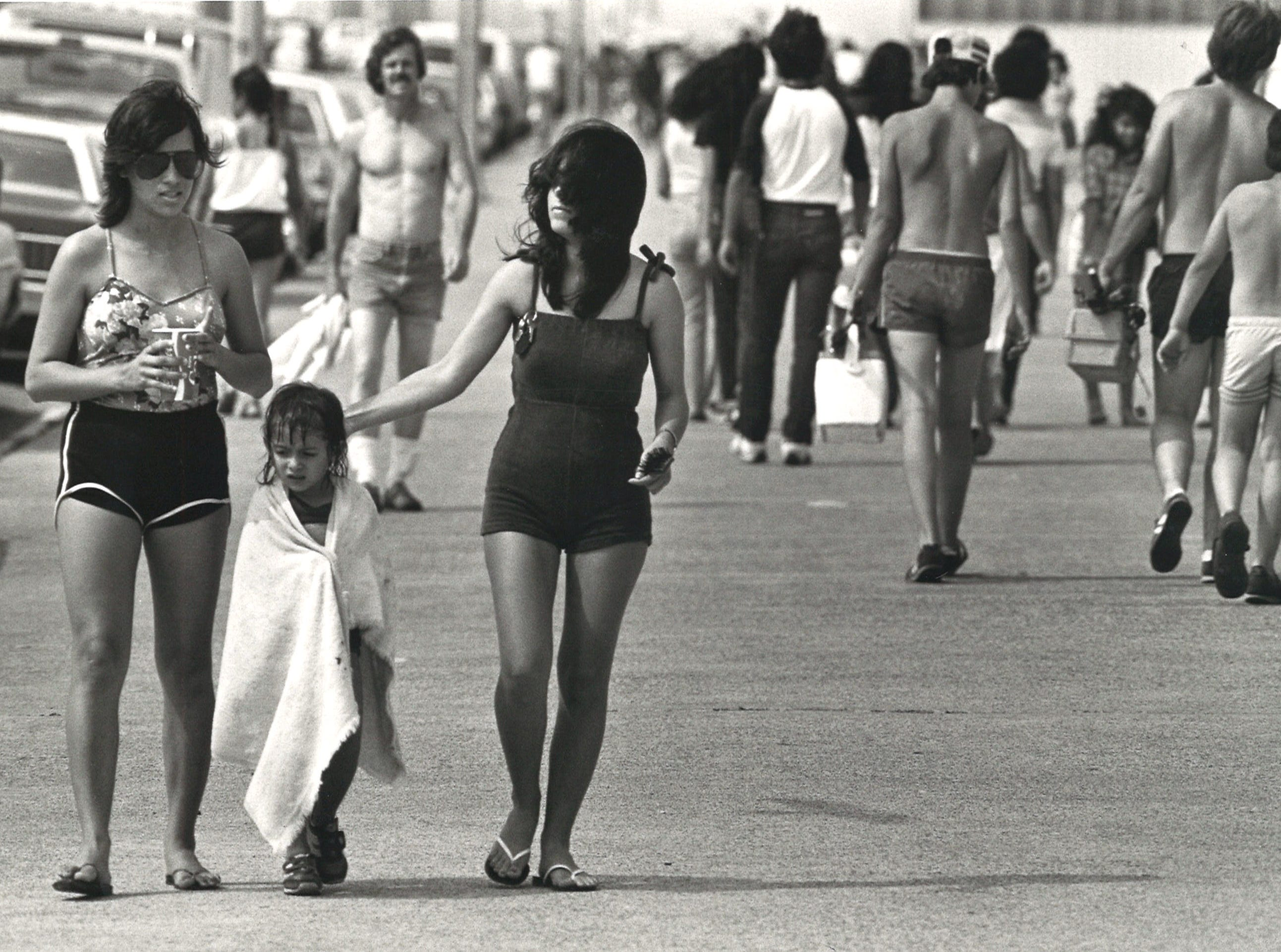 The sidewalk above the seawall at McGee Beach in downtown Corpus Christi was heavy with pedestrian traffic on May 8, 1983.