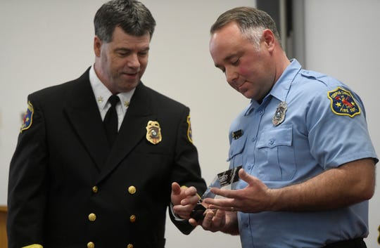 John Honeycutt, right, is awarded inspector of the year, Wednesday, March 27, 2019. Honeycutt has been a Corpus Christi firefighter for 18 years and in fire prevention for nine years.