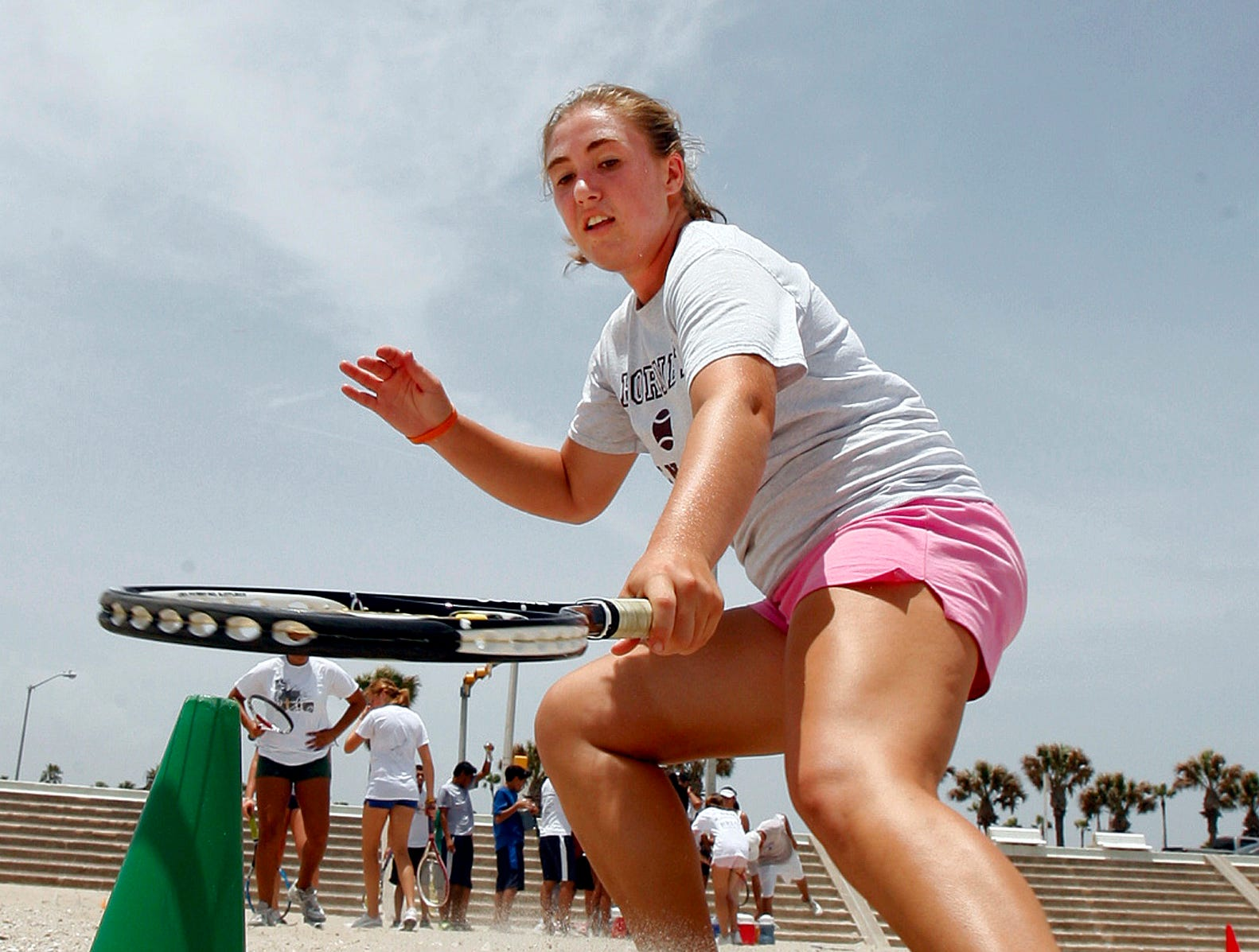 Kemper Christensen, a Flour Bluff high school senior, participates in a tennis camp on McGee Beach in downtown Corpus Christi in July 2009.