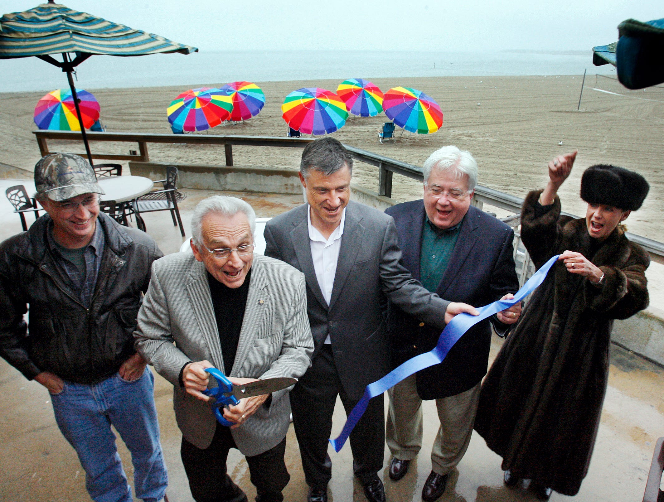 City Councilman Mike Hummell (left to right), Mayor Henry Garrett, Omni Hotel general manager Nils Stolzlechner, Corpus Christi Chamber of Commerce President Foster Edwards, and Omni Hotel director of Sales Paulette Good, were on hand for the ribboncutting of the new Seawall Beachfront Cafe next to McGee Beach in downtown Corpus Christi in March 2009.