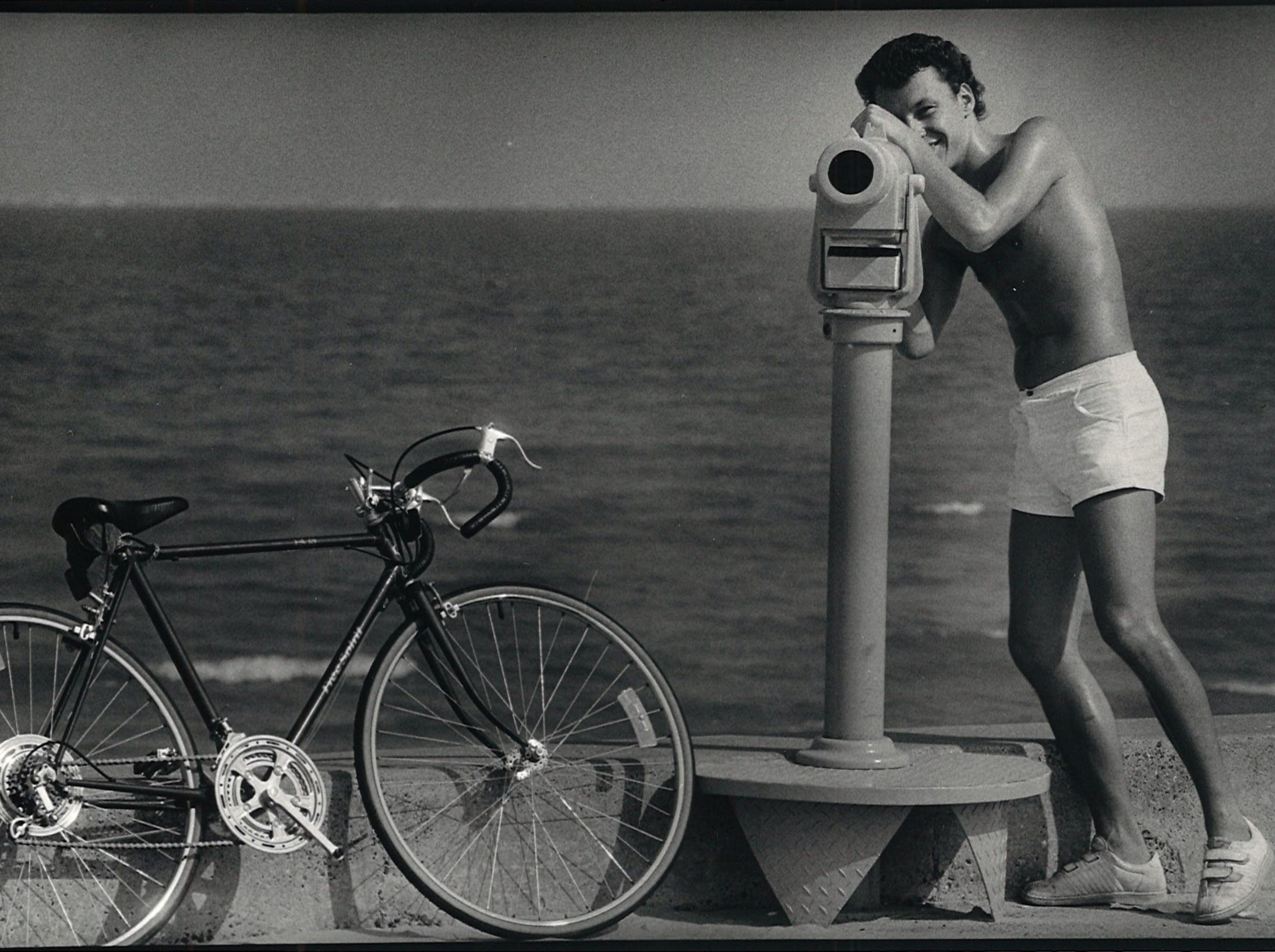 Peter McDaniel, 23, stops during his bike ride from Naval Air Station Corpus Christi to Bayfront Plaza Convention Center to check out the new telescopes on McGee Beach in downtown Corpus Christi on Sept. 4, 1987.