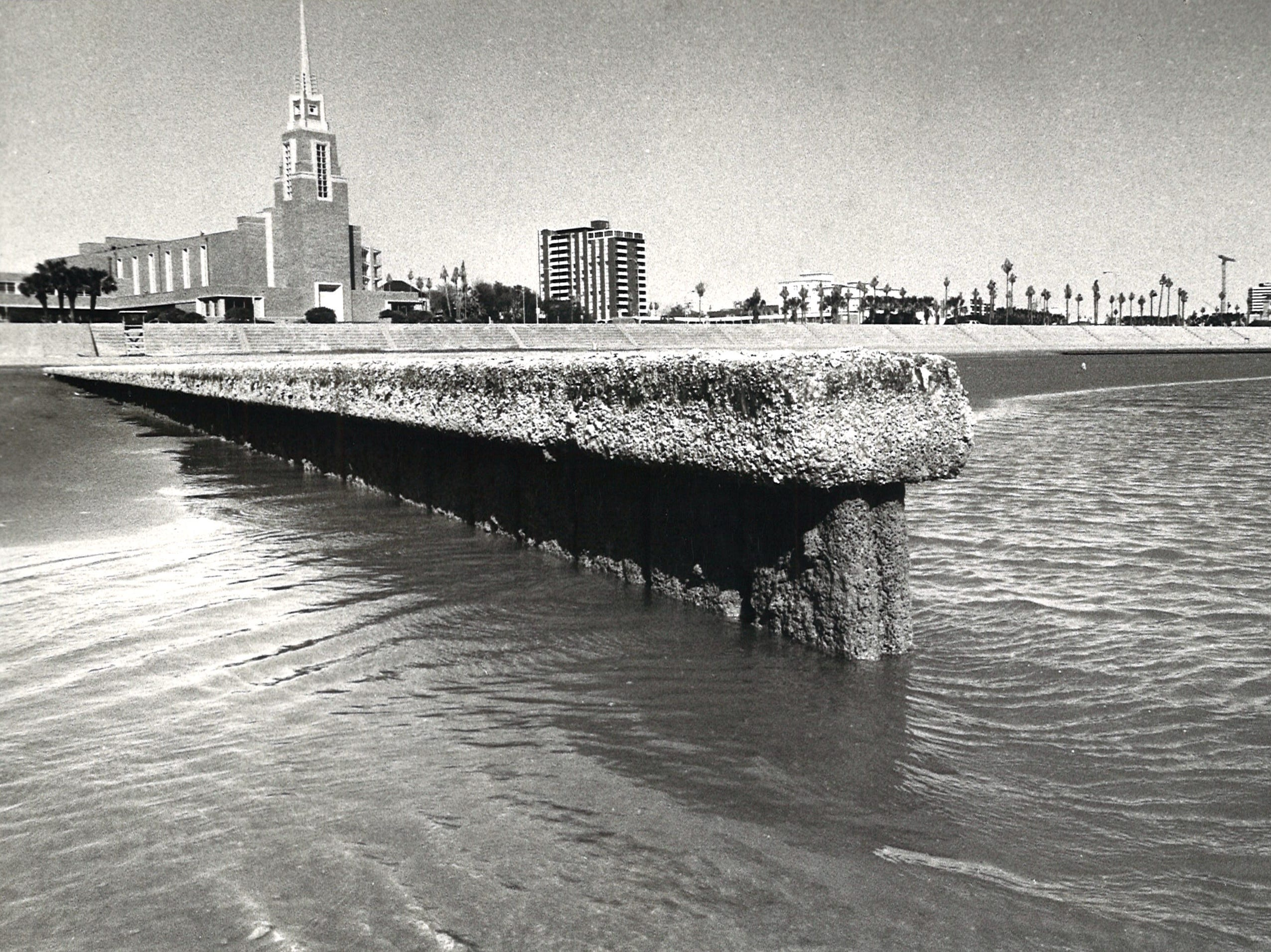 Low tide at McGee Beach in downtown Corpus Christi exposed the ends of the short breakwaters Feb. 28, 1984.