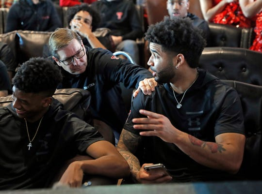 Texas Tech assistant coach Mark Adams talks to Brandone Francis, right, during a watch party for the NCAA men's Division I college basketball tournament selection show Sunday, March 17, 2019, in Lubbock, Texas. (Brad Tollefson/Lubbock Avalanche-Journal via AP)