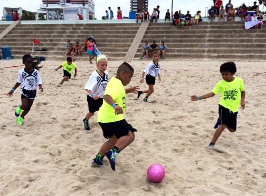 More than 1,300 soccer players from 153 teams filled McGee Beach in downtown Corpus Christi for Express Beach's ninth annual Soccer Fest Saturday, June 29, 2014.