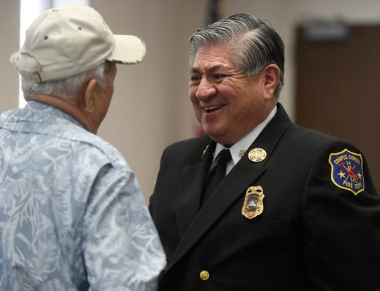 Corpus Christi Fire Chief Robert Rocha talks to Dickie Rose before the ceremony, Wednesday, March 27, 2019. Rose, who is a retired firefighter, came to watch his son John receive inspector of the year.