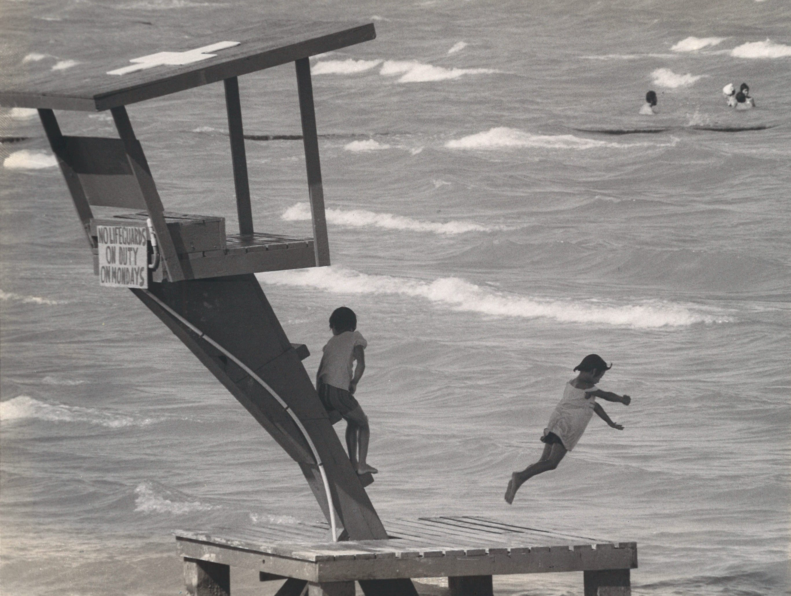 Two children play on the lifeguard stands on McGee Beach in downtown Corpus Christi on Aug. 8, 1977.