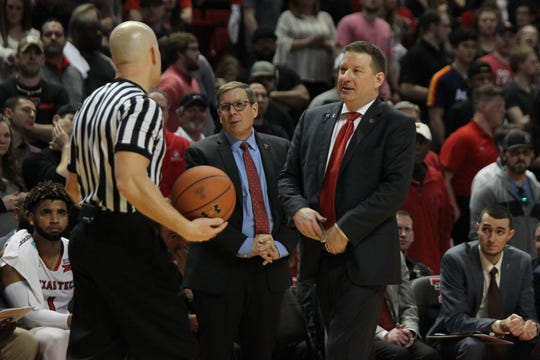 Mar 3, 2018; Lubbock, TX, USA; Texas Tech Red Raiders head coach Chris Beard and assistant coach Mark Adams discuss a call with an official during the game against the TCU Horned Frogs at United Supermarkets Arena. Mandatory Credit: Michael C. Johnson-USA TODAY Sports