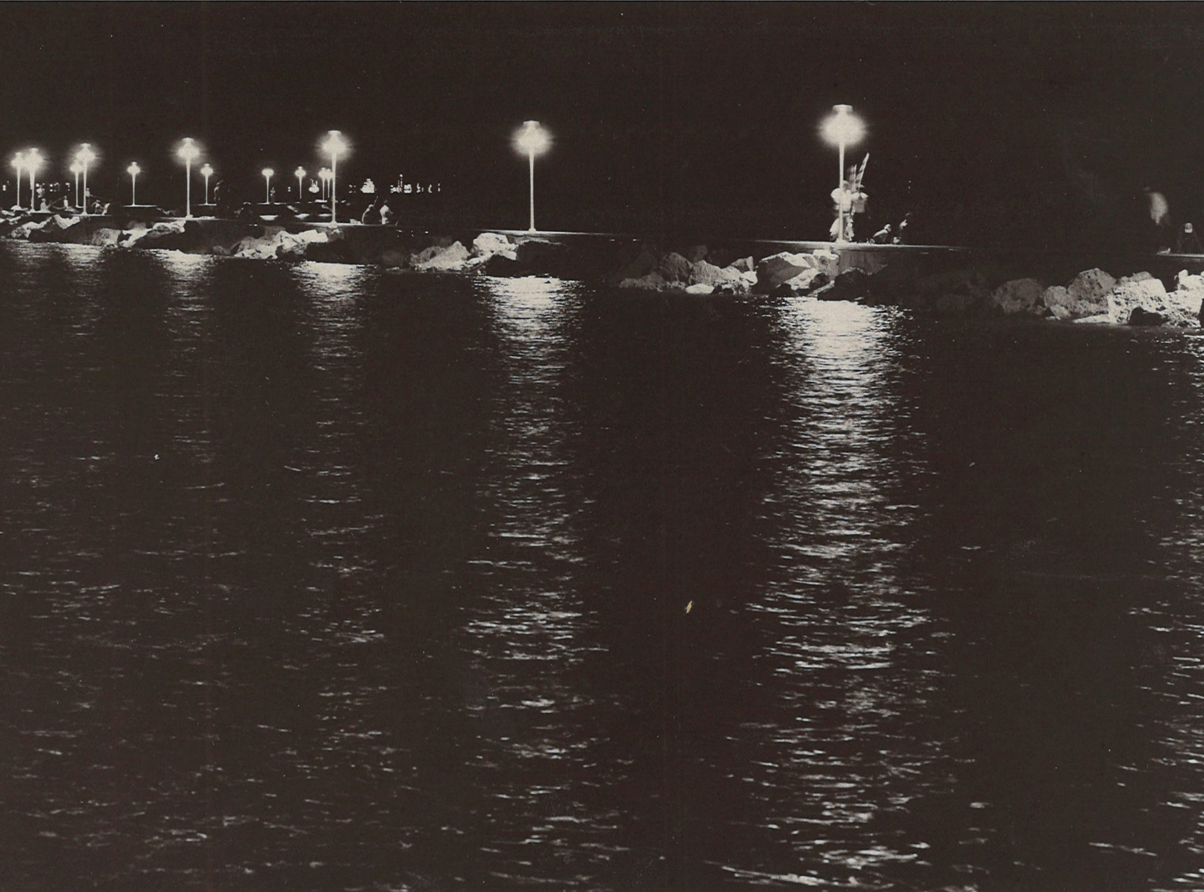 The city installed 17 lights along the breakwater sidewalk at McGee Beach in downtown Corpus Christi in 1975. Fisherman gathered around the lights when this photo was taken the evening of Sept. 23, 1975.