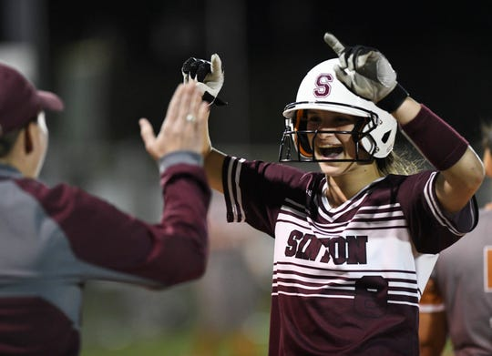 Sinton's Autumn Moses high-fives her coach during the game against Beeville, Tuesday, March 26, 2019. Sinton won, 4-1.