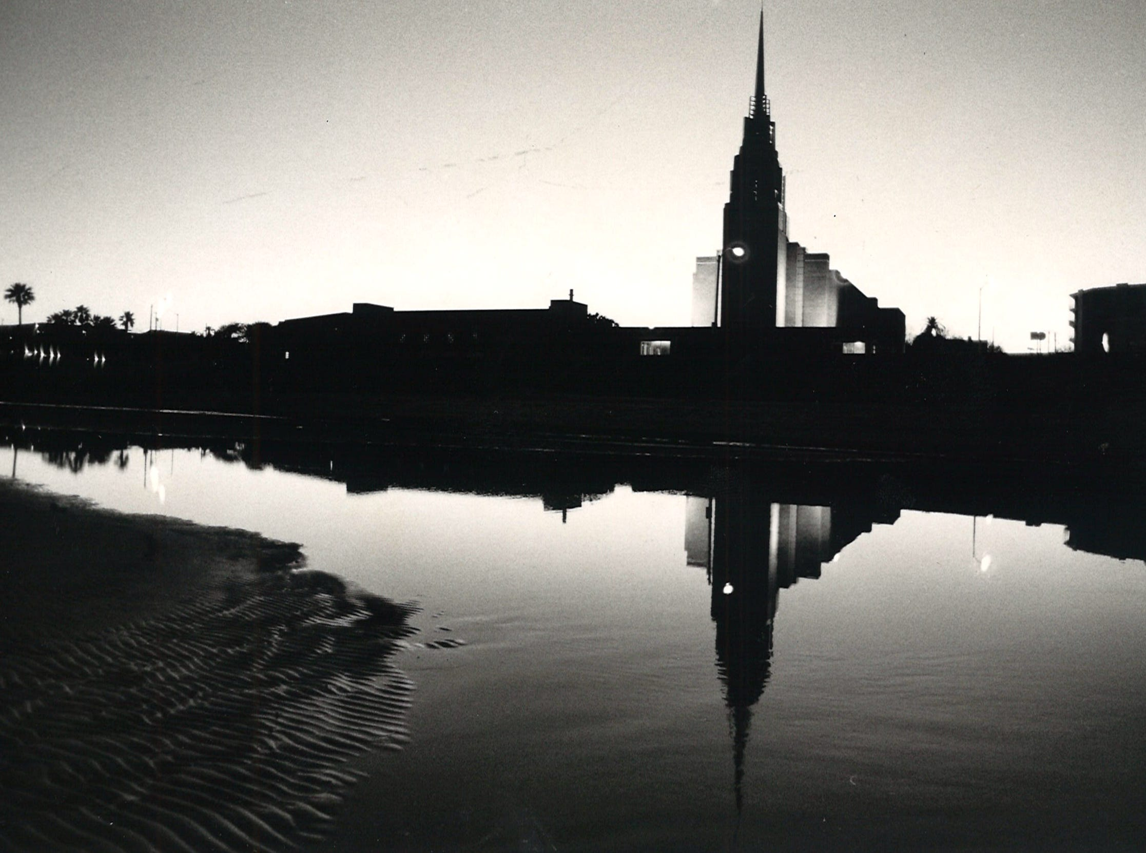 Extreme low tides left puddles of water on McGee Beach in downtown Corpus Christi as the sun sets on Jan. 7, 1985. First United Methodist Church is reflected in one of the pools.