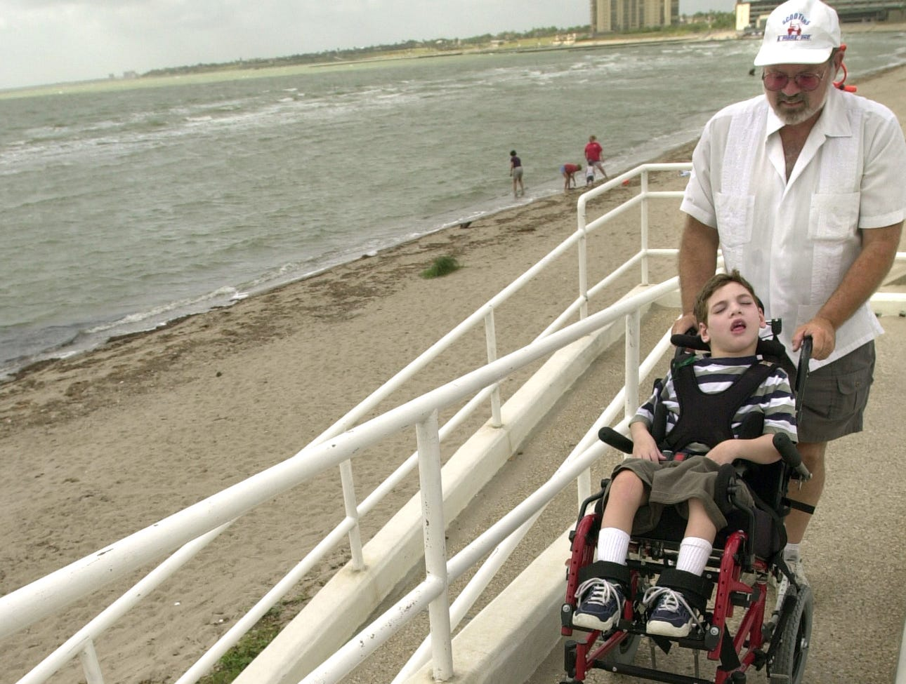John Madden and his son John Terry manuveur up the wheelchair ramp at McGee Beach in downtown Corpus Christi in June 2007.