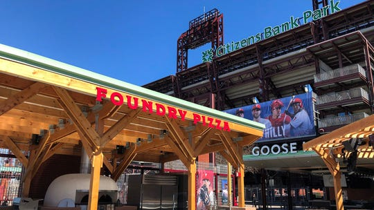 The new indoor-outdoor concession has a pizzeria, a beer bar, picnic tables, a mini waterfall and more. Here, Foundry Pizza and Goose Island stands at Citizens Bank Park are ready for the Phillies Opening Day.