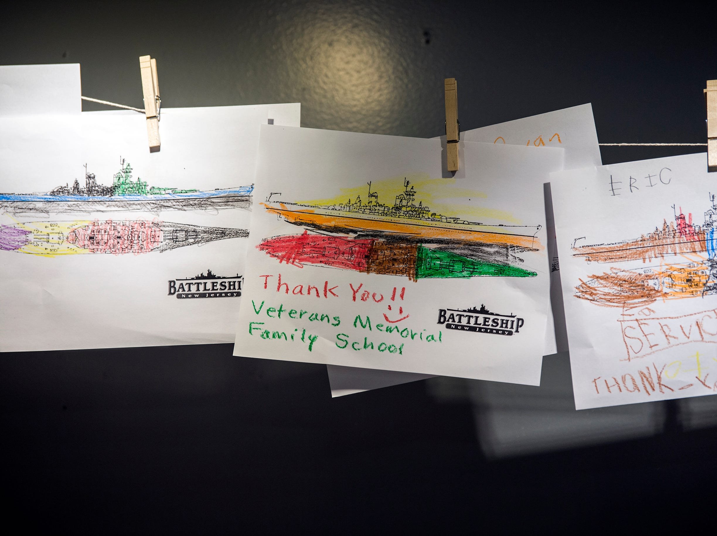 Thankyou notes from students are hung up during the unveiling of Jason's Kids Kompartment Thursday, March 21, 2019 aboard the USS New Jersey battleship in Camden, N.J.