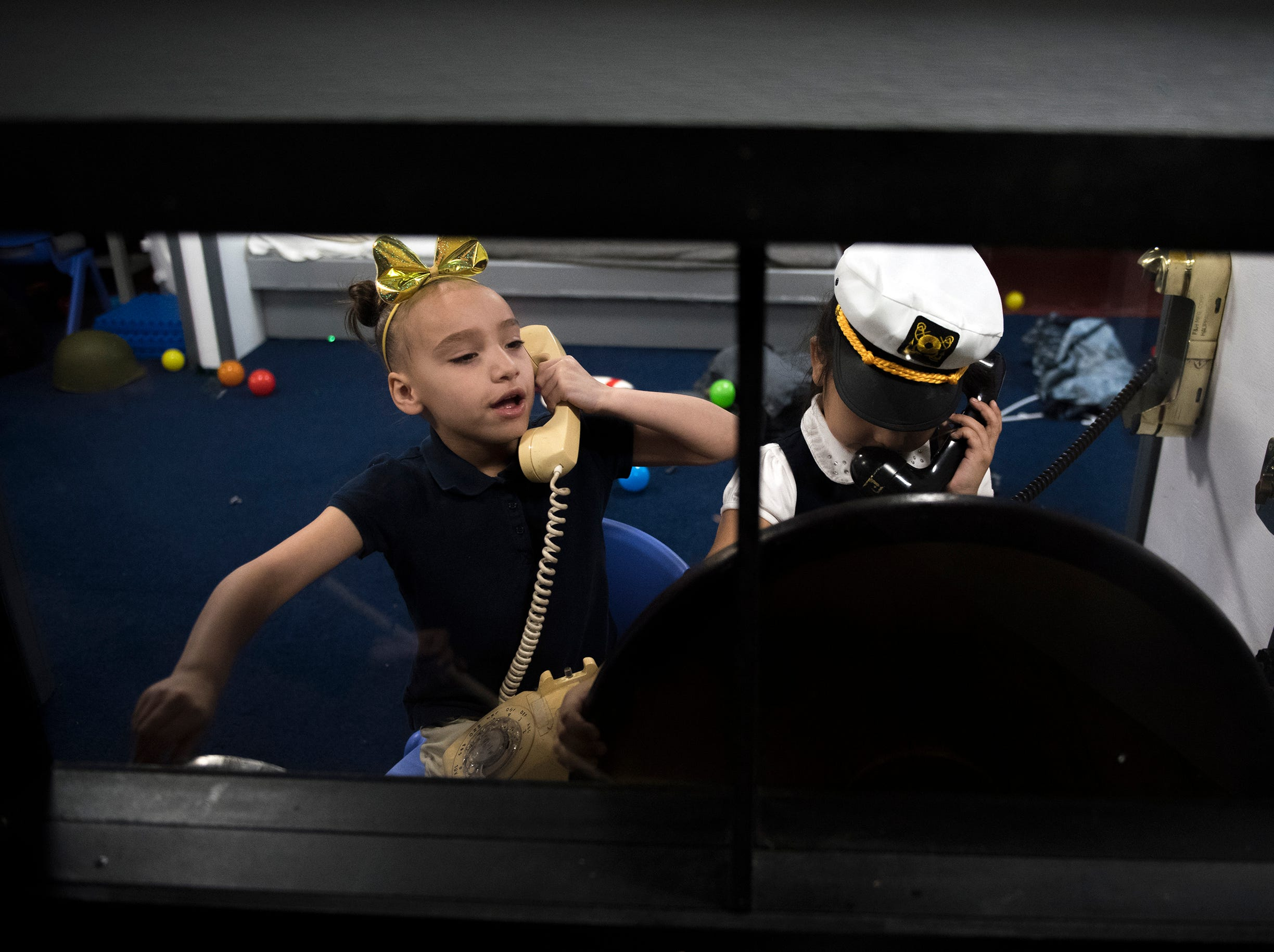 Pre-schoolers Yolyani Gilmore, left, and Areli Cortes play at Jason's Kids Kompartment Thursday, March 21, 2019 aboard the USS New Jersey battleship in Camden, N.J.