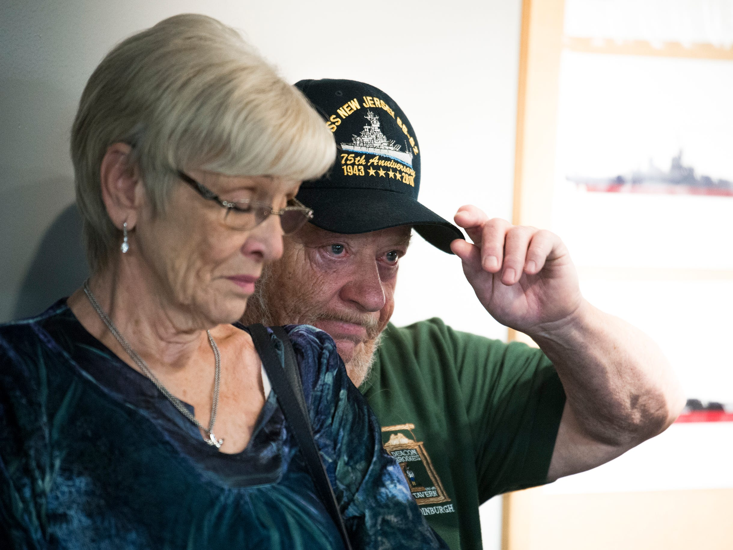 Scott Hall, right, tips his cap alongside his wife Denise Hall during the unveiling of Jason's Kids Kompartment Thursday, March 21, 2019 aboard the USS New Jersey battleship in Camden, N.J. Their son Jason Hall was the ship's curator and came up with the idea for the play area. Jason died of cancer in June 2018.