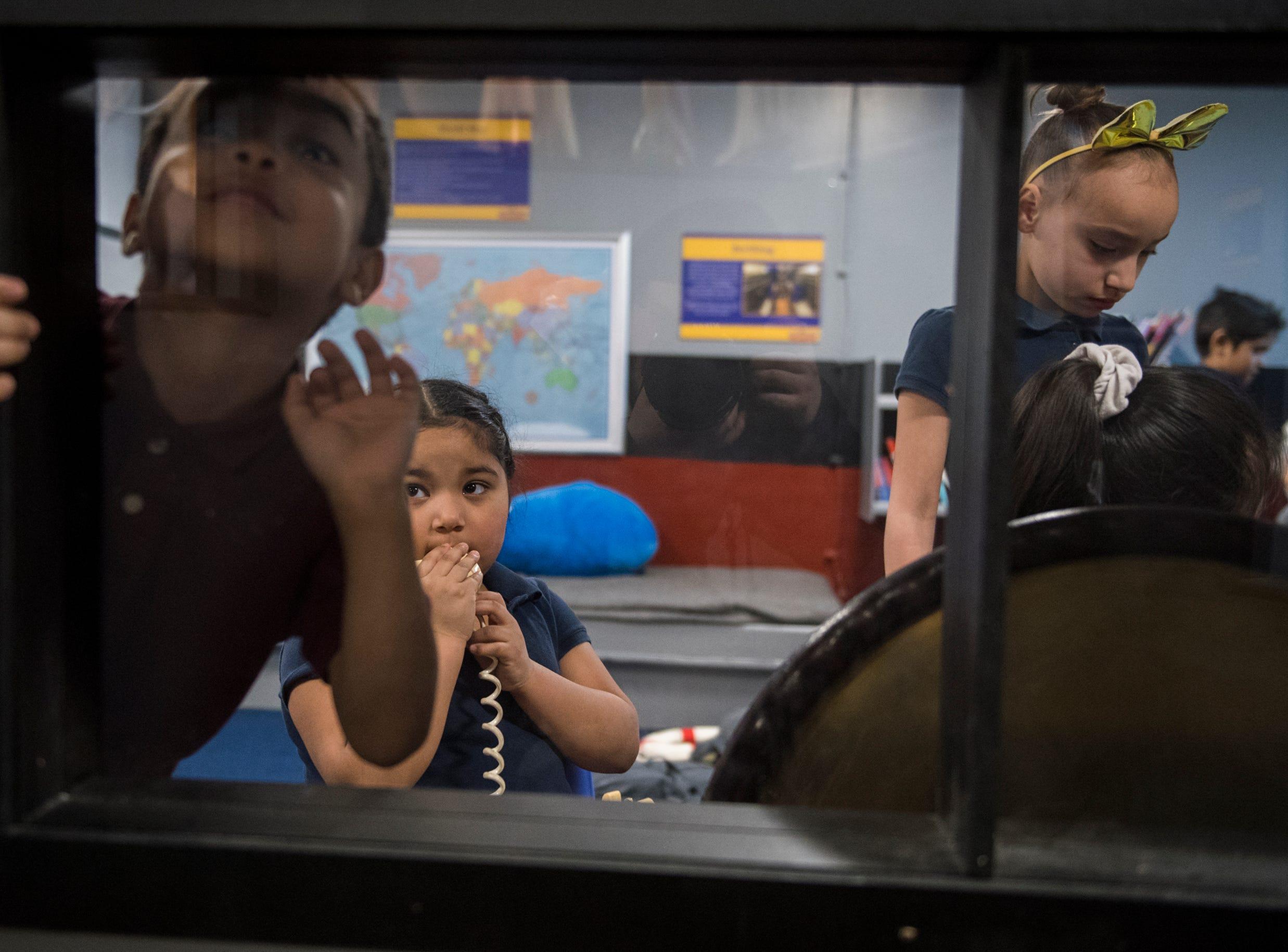 Pre-schoolers play inside Jason's Kids Kompartment Thursday, March 21, 2019 aboard the USS New Jersey battleship in Camden, N.J.