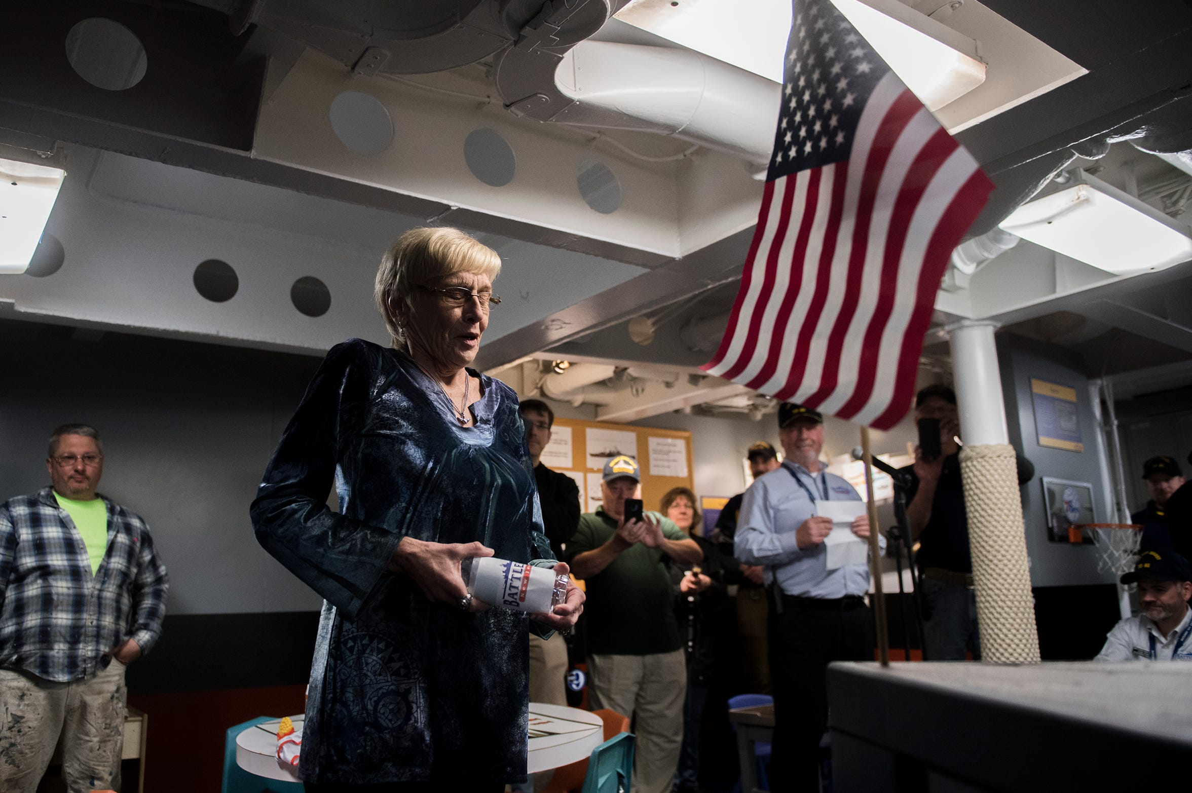 Denise Hall pauses for a moment before 'christening the ship' inside Jason's Kids Kompartment Thursday, March 21, 2019 aboard the USS New Jersey battleship in Camden, N.J. Denise Hall's son Jason Hall was the ship's curator and came up with the idea for the play area. Jason died of cancer in June 2018.