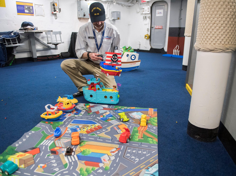 Development Director Clark Perks cleans up following the unveiling of Jason's Kids Kompartment Thursday, March 21, 2019 aboard the USS New Jersey battleship in Camden, N.J.