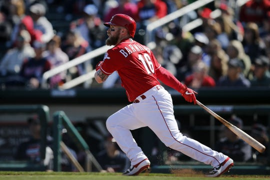Cincinnati Reds catcher Tucker Barnhart (16) doubles in the bottom of the fourth inning of the spring training opener between the Cleveland Indians and Cincinnati Reds at Goodyear Ballpark in Goodyear, Ariz., on Saturday, Feb. 23, 2019.