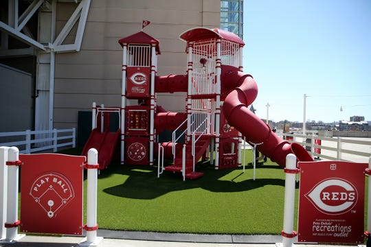 A new kids play set, next to the Hitching Post Outpost Bar, is located in the fan zone, Wednesday, March 27, 2019, at Great American Ball Park in Cincinnati.