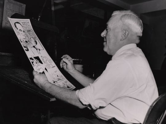 March 1950: Enquirer sports cartoonist Harold E. Russell.