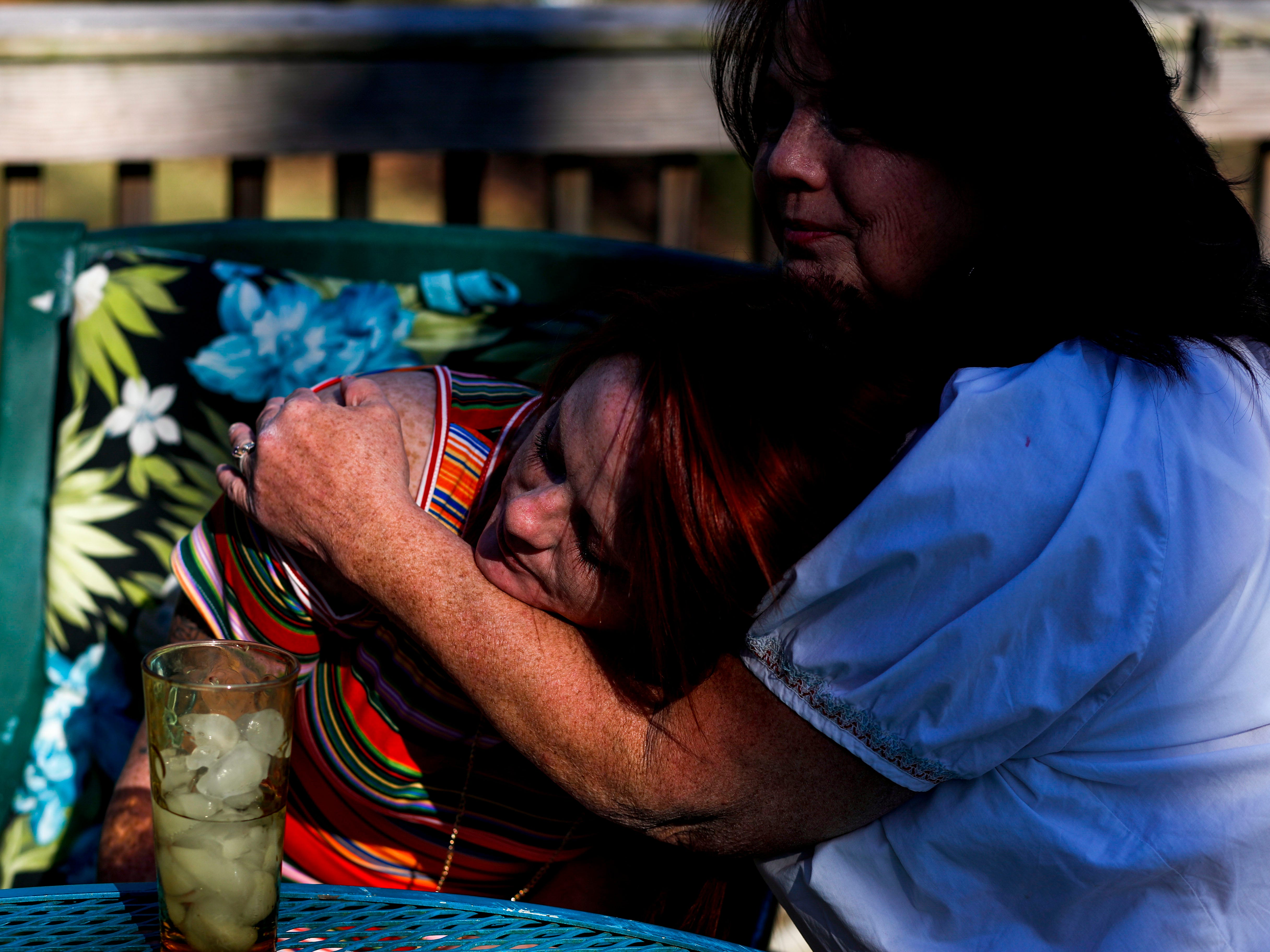Colleen Lindsay, right, holds her daughter Lacie Sloan while talking about Natalie Lyle, Sloan's daughter who took her own life last month.