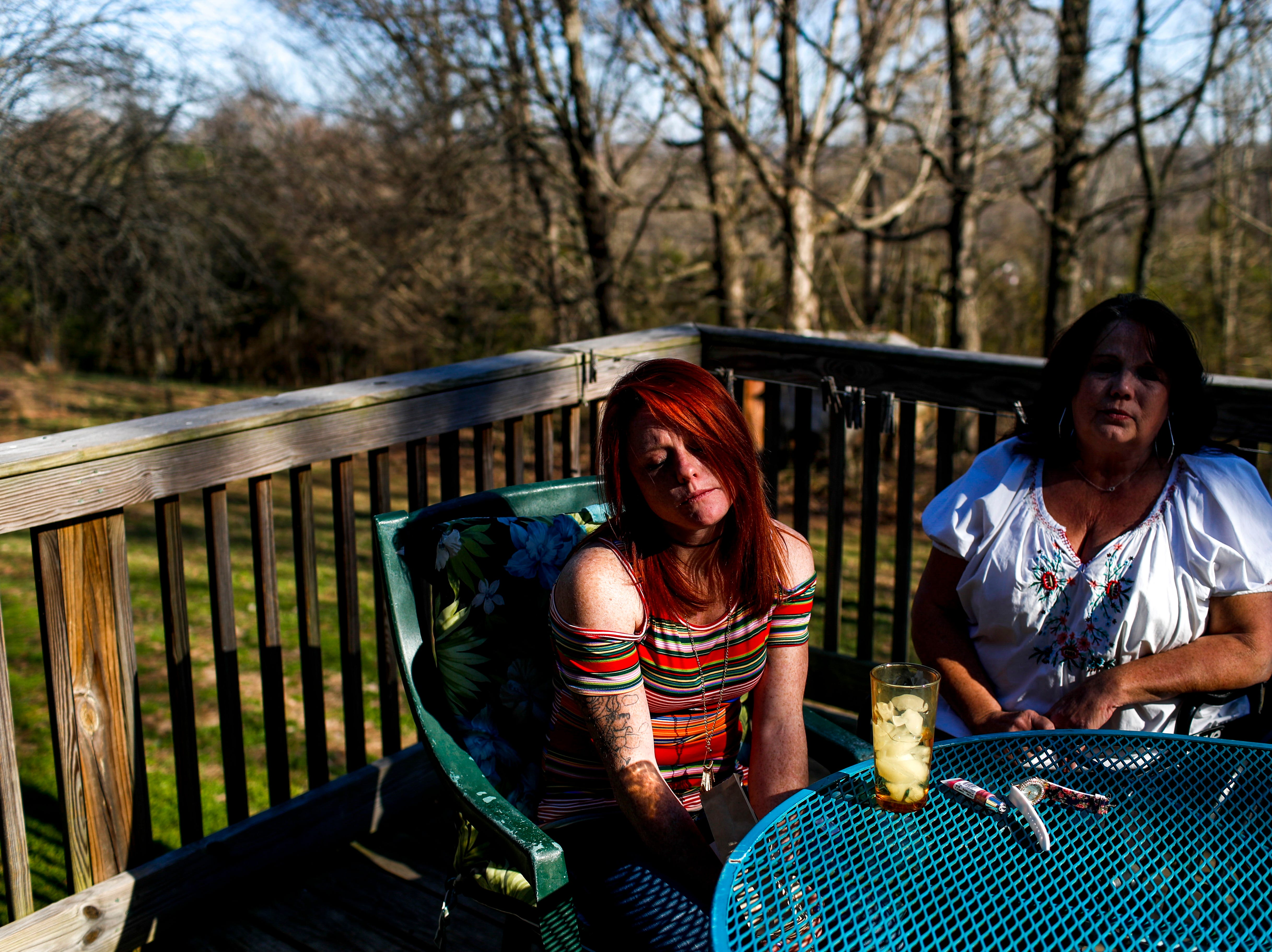 Lacie Sloan, left, and Colleen Lindsay, right, sink into their chairs on the back porch while speaking to The Leaf-Chronicle about Sloan's daughter Natalie Lyle, who took her own life, at the Lindsay residence in Clarksville, Tenn., on Friday, March 22, 2019.