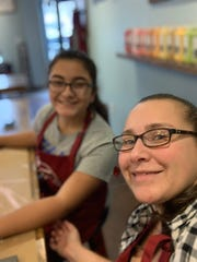 Angela Rivera, front, is pictured with her 14-year-old daughter, Kayla, at a Nailed It D.I.Y. Studio in North Carolina. The visit inspired her to open an location in Somerville in June.