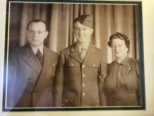 One of the photos hanging at Chester House Bar in Manville is of its founders Chester Sr. and Stella Trojanowski flanking their WWII veteran son, Chester Jr., who is the current owner's father. The 102-year-old Chester House run by the Trojanowski family for three generations will most likely close in April. In the near future, a Royal Farms convenience store and gas station will stand where Chester House made its mark in the borough.