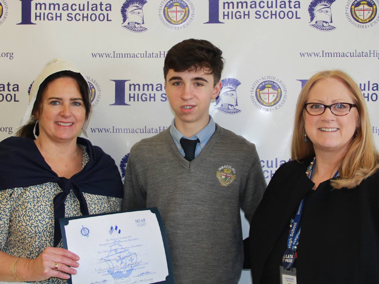 Immaculata Junior Bernie Senger IV of Califon won the Camp Middlebrook Chapter of the Daughters of the American Revolution's Christopher Columbus essay contest, as well as placing third in the state. Along with Immaculata Head of School Joan Silo (right), Erika White, DAR representative in a colonial costume, awarded a certificate and monetary award to Bernie.