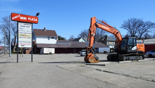 Salvage of materials from structures at the former Newell's Mini-Plaza occurred last week. Demolition of buildings started Monday morning. According to permits and plans on file with the city, the locations is targeted to be the home of a new 10,000 square-foot Dollar General store.