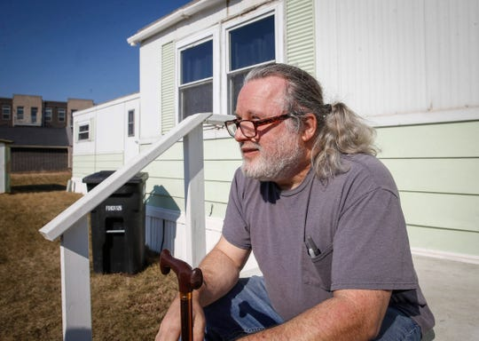 Matt Chapman, a community organizer, talks Tuesday, March 26, 2019, at Midwest Country Estates in Waukee, where he and other residents of the mobile home park were notified that their rents will go up by more than $200.