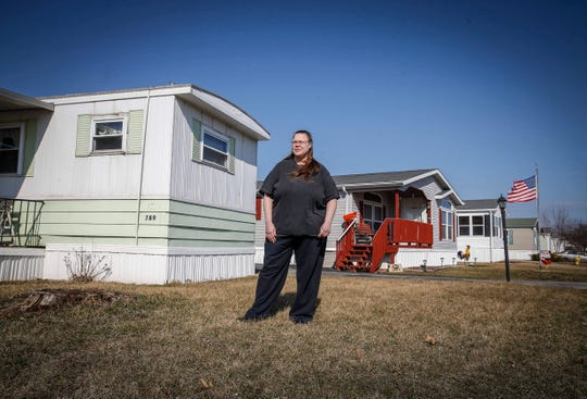 Janet Hook poses for a photo outside her mobile home on Tuesday, March 26, 2019, at Midwest Country Estates in Waukee. A new company has purchased the mobile home park and advised residents there of its intention to raise monthly rents by $205.