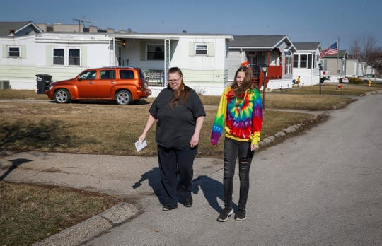 Janet Hook walks along Collins Drive with her daughter, Rebekah Wiles, 16, on Tuesday, March 26, 2019, at Midwest Country Estates in Waukee. A new company has purchased the mobile home park and advised residents there of its intention to raise monthly rents by $205.
