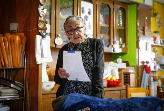 Arletta Swain, 91, of Waukee reads from a letter her and other residents of the Midwest Country Estates mobile home park received from the the property's new owners stating its intention to raise monthly rents by more than $200.