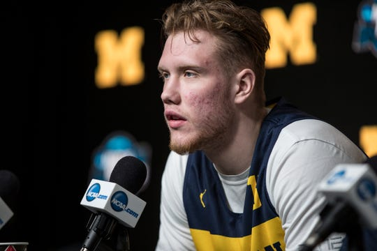 Michigan forward Ignas Brazdeikis answers a question during a press conference as the Wolverines prepare for Thursday's Sweet 16 game at the Honda Center in Anaheim, Calif., Wednesday, March 27, 2019.