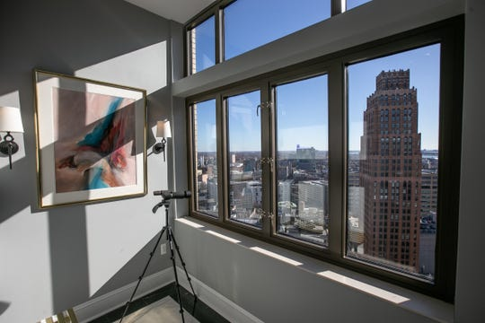 The unending views of  downtown Detroit from the Book Cadillac penthouse include this neighbor, the David Stott Building. Damaged and closed by broken pipes, it was  renovated and reopened last year as retail and office space with high-end apartment rentals above.