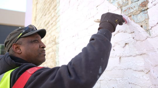 On the east-facing side of the Detroit Foundation Hotel at 234 W. Larned in Detroit, muralist Hubert Massey, 60, is bringing back to life the work of legendary Detroit artist Charles McGee.