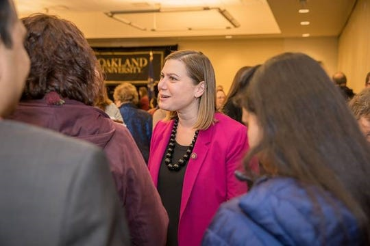 U.S. Rep.  Elissa Slotkin, D-Holly, meets with people at a town hall meeting at Oakland University in Rochester in March 2019.