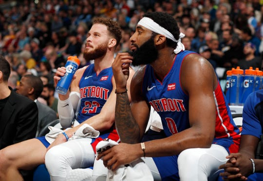 Pistons center Andre Drummond, front, and forward Blake Griffin sit on the bench in the first half on Tuesday, March 26, 2019, in Denver.
