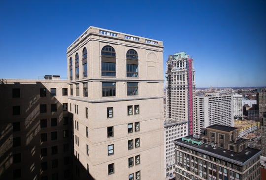 Three-story tall arched windows encircle this penthouse at the top of the Westin Book Cadillac -- floors 29, 30 and 31. On the 31st floor,  the arches form the unusual windows in owners' suite.