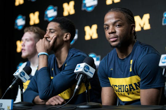 Michigan guard Zavier Simpson, guard Charles Matthews and forward Ignas Brazdeikis prepare to answer questions during a press conference as the Wolverines prepare for Thursday's Sweet 16 game at the Honda Center in Anaheim, Calif., Wednesday, March 27, 2019.