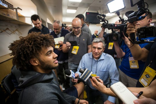 Michigan forward Isaiah Livers answers questions during media availability in the locker room at the Honda Center in Anaheim, Calif., Wednesday, March 27, 2019.