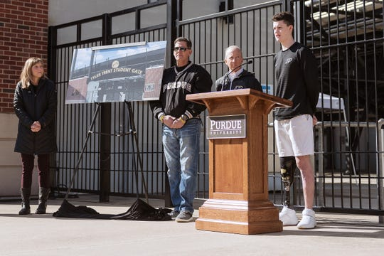 Sean English, the inaugural recipient of the Tyler Trent Courage and Resilience Award, speaks about the honor as, from left, Tyler's parents Kelly and Tony Trent, and Purdue President Mitch Daniels look on. The Trents unveiled the memorial gate in honor of their son at the entrance of Ross-Ade Stadium as Daniels announced the gate and the scholarship recipient. (Purdue University Photo/Rebecca Wilcox)
