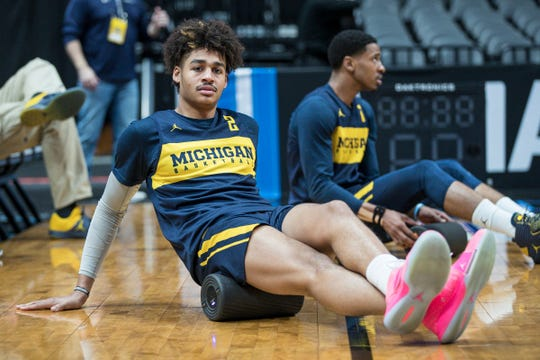 Michigan guard Jordan Poole and guard Charles Matthews warm up on the court during practice as the Wolverines prepare for Thursday's Sweet 16 game at the Honda Center in Anaheim, Calif., Wednesday, March 27, 2019.