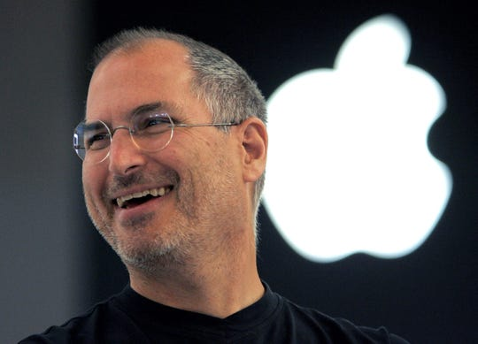 In this 2005 photograph, Apple co-founder Steve Jobs smiles after a press conference when he opens the Apple Expo in Paris. Since his death in 2011, Jobs has been the subject of documentaries, books, a movie or even a comic book character.