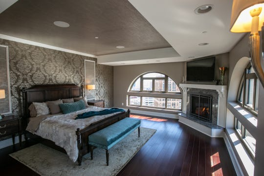 The owners suite gets its half-circle windows from the arches at the top of the three-story windows. All three bedrooms have marble baths that blend contemporary and Neo-Renaissance style at the Book Cadillac penthouse that's for sale in downtown Detroit.