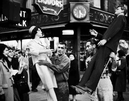 Mannequins of John and Jackie Kennedy being moved in New York City, 1961.